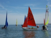 Dinghy sailors enjoying annual regatta.