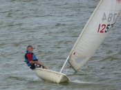 Dinghy Regatta - Laser sailor flying along!